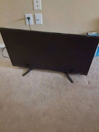 black flat screen TV with remote 2056 mi