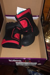 Kids totes boots-- new in box-- have a children's sizes 5 and 6