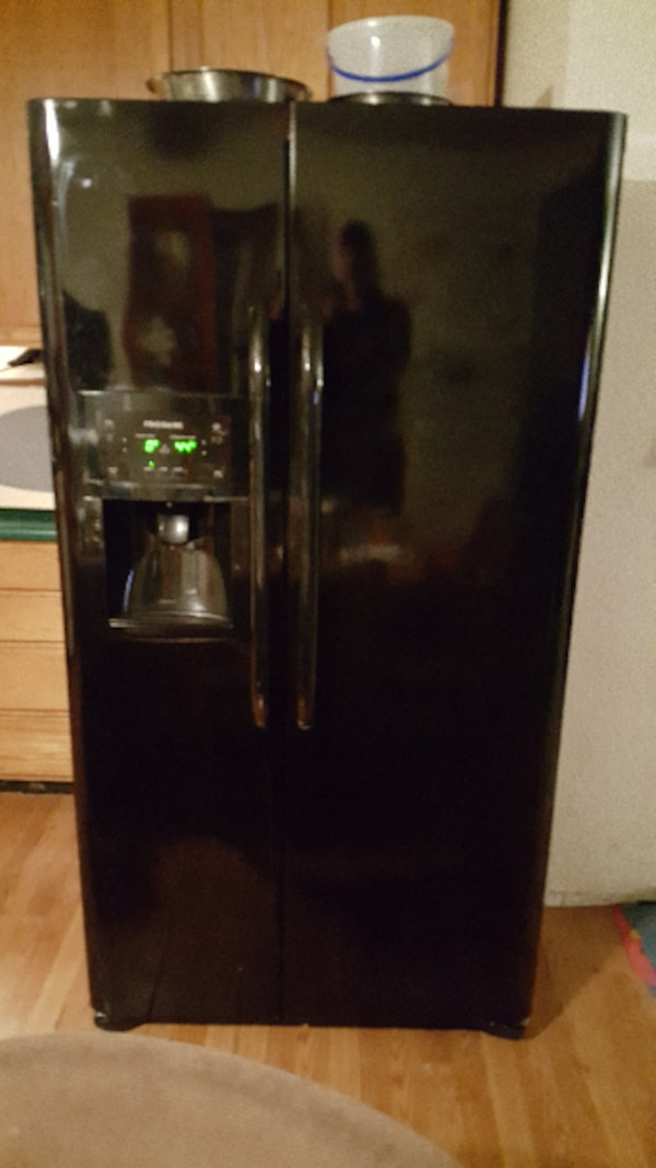 black side-by-side refrigerator with dispenser