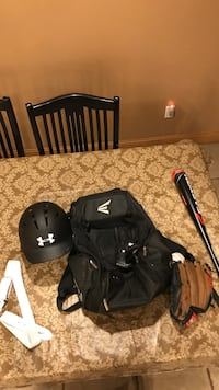 black Under Armour baseball helmet and bat Glen Cove, 11542
