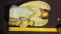 praying man and angel wooden figurine