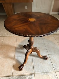 Brown wooden pedestal table with chair