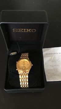 round gold Seiko chronograph watch with link bracelet