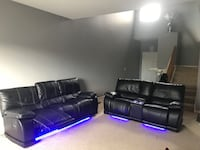 Two black leather recliner sofa