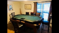 Very nice Poker table. I have the legs to go with the table. Has dealer chip table and raised platform for the cards. Each seat has its own cup holder 99 mi