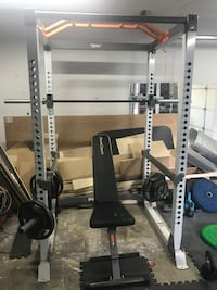 Full cage squat rack , multi position bench and 300lb barbell / weight set