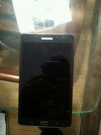 black Samsung tablet.Charger included. Mint condit