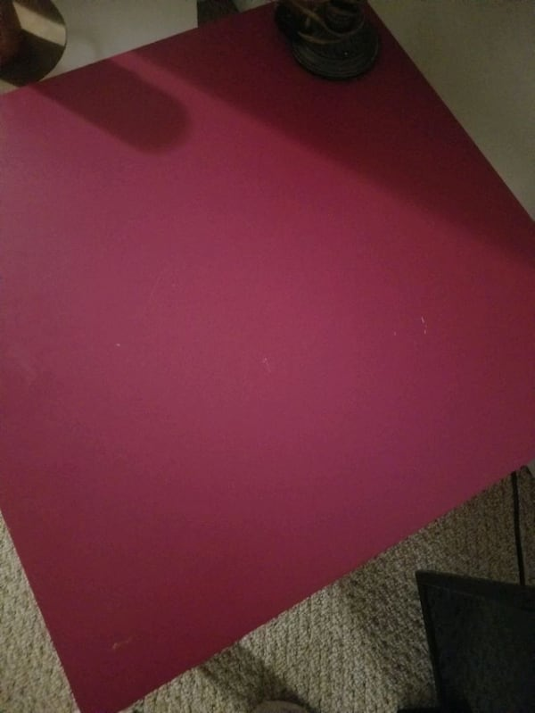 pink end table or side table. f47b1060-6098-49ad-b328-06a50bc300a9