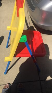 red, yellow, and blue plastic easel Raleigh, 27610