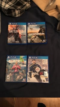four assorted PS4 game cases Central Okanagan, V4T 1C8