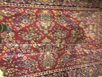 red, white, and black floral area rug null