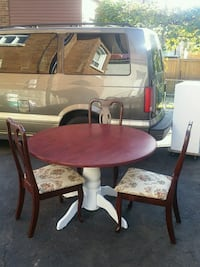 round brown wooden table with four chairs dining set Toronto, M6E 3H6