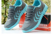 pair of gray-and-blue Nike running shoes North Vancouver, V7R 2L3