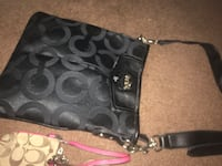 women's black leather Coach sling bag