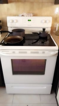 white and black induction range oven Châteauguay, J6K 3T7