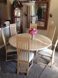 57 inch round marble table with 6 chairs. Priced to sell. Paid over $2000 for it. Heavy, top alone will take 3 people to carry. Hurry, this won't last!