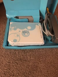 Wii gaming console with games and remotes.