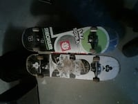 two white-and-black assorted prints skateboards