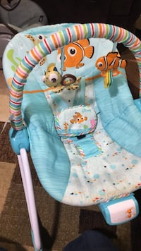 baby's teal and white Disney Finding Nemo themed bouncer Lorton, 22079