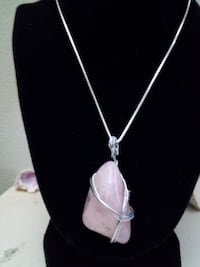 silver-colored pendant necklace null