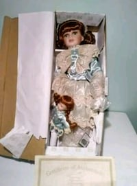white and brown dressed doll in box Washington, 20019