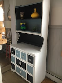 white and black wooden TV hutch with flat screen television
