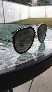 Black and gold framed Gucci sunglasses