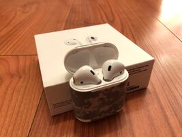 Apple AirPods (1st gen) with charging case and box