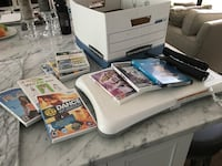 white Nintendo Wii console with game cases Rockville, 20852