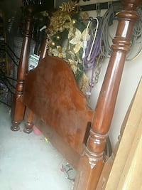 brown wooden headboard and matching footboard