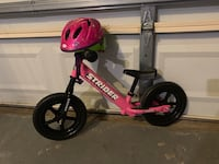 toddler's red and black Strider balance bike Laurel, 20708