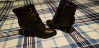 pair of black leather boots 668 mi