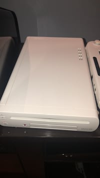 Wii U. Has barely been used. Comes with two games Toronto, M3L 2C7