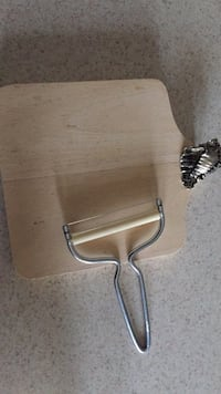 Small cheese board with cutter