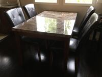 Rectangular brown wooden table with four chairs dining set West Vancouver, V7S 1V4