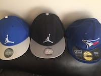 Two black and blue air jordan fitted caps