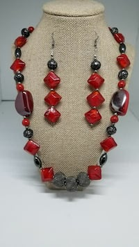 red and brown beaded necklace and pair of hook earrings