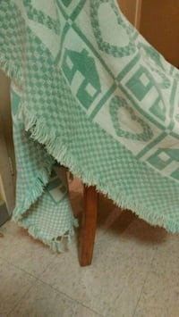 Green & white throw blanket