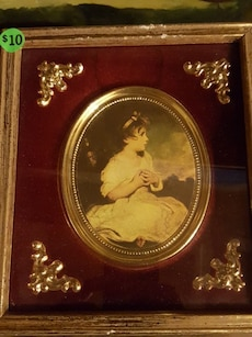 girl in white dress sitting on the floor painting with wooden frame