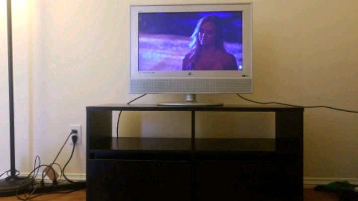 gray flat screen television with TV stand for sale  Long Beach