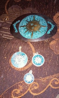 belt buckle and 3 pendants (no chains)