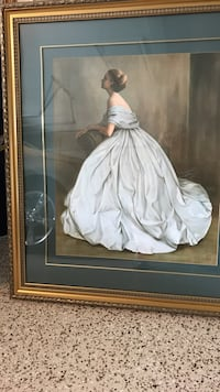 brown wooden framed painting of woman wearing white dress
