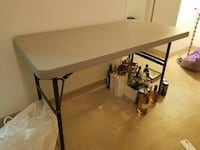 rectangular brown wooden folding table