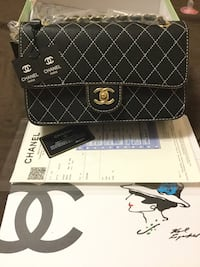 Black and white chanel leather wristlet 550 km
