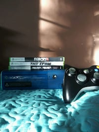 Used Xbox 360 E with 4 games Bloomington, 92316
