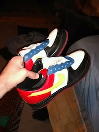 unpaired white, blue, and red Nike sneaker Columbus, 43213