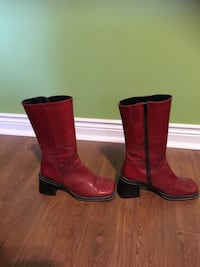 Pair of red leather side-zipped square-toe chunky heel mid-calf boots