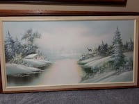brown wood-framed snow covered river painting