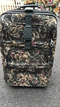 black, beige, and blue floral luggage Upper Providence, 19426