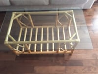 rectangular brown wooden glass top coffee table